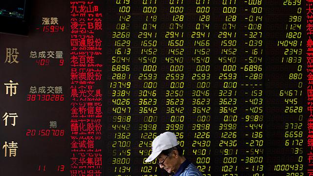 הממשל מנתב את פעילות המגזר הפרטי כולו והבורסה של שנגחאי היא חלק ממארג זה. היא נועדה לשרת את מטרות המשק (צילום: AP) (צילום: AP)