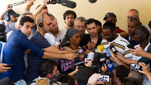 Reporters swarm around Mengistu's mother, father and other family members (Photo: Reuters) (Photo: Reuters)