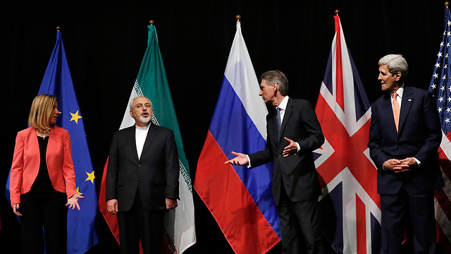 EU foreign policy chief Mogherini, Iranian Foreign Minister Zarif, then-British Foreign Secretary Hammond and US Secretary of State Kerry at the signing of the nuclear agreement (Photo: AP)