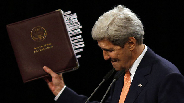 Kerry with the deal in hand. (Photo: AFP) (Photo: AFP)