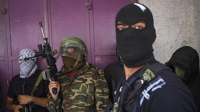 Armed men at Qalandiya checkpoint (Photo: Getty)