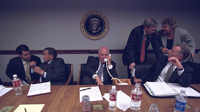 Cheney on a phone call while officials clamor (Photo: Reuters)
