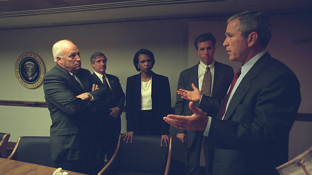 President Bush speaks to the other officials (Photo: Reuters)