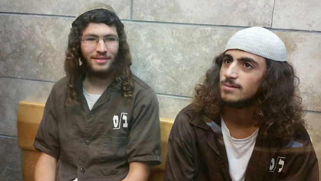 Yinon Reuveni, right, and Yehuda Asraf, at court after allegedly setting fire to the Church of Multiplication in Tiberias (Photo: George Ginsburg)