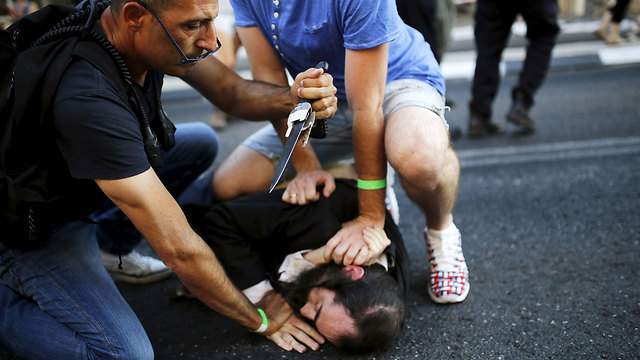 Yishai Schlissel being apprehended after the 2015 Pride Parade attack (Photo: Reuters)