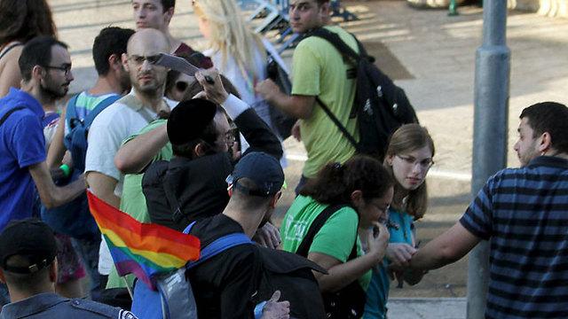 Shlissel attacks marchers at the Jerusalem Pride Parade (Photo: Reuters)