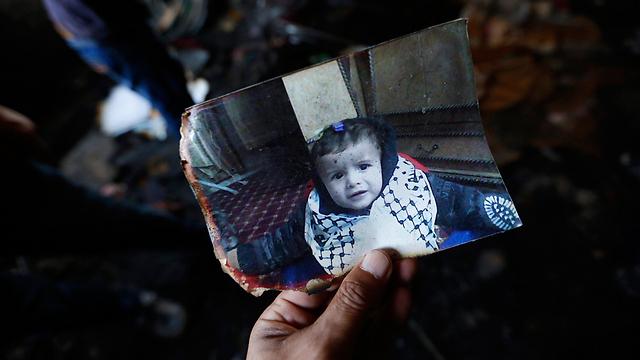 A photo of Ali in the burnt out home in Duma (Photo: EPA) (Photo: EPA)