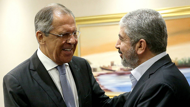 Lavrov and Mashal meet in Doha (Photo: MCT)