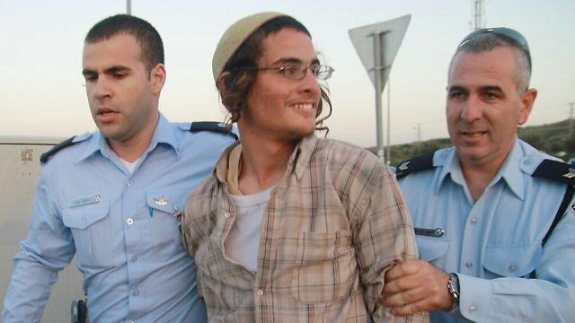 Ettinger during his arrest (Photo: Ohad Amiton, TPS)