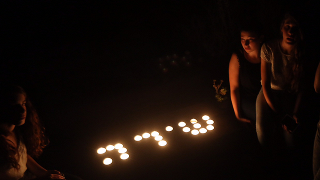 Shira's name spelled out in Hebrew with candles (Photo: Gil Yohanan)