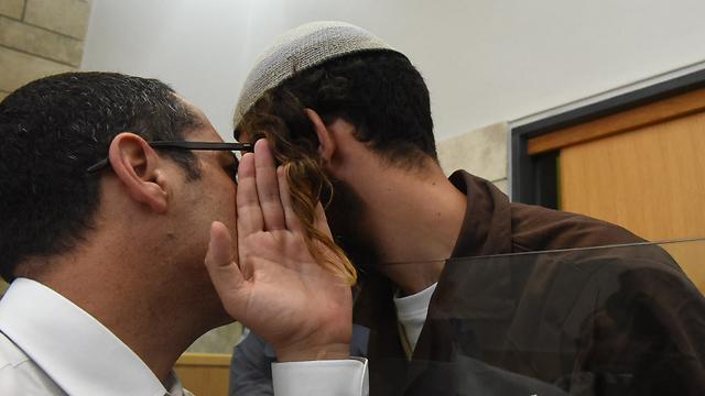 Ettinger in court with his attorney (Photo: Avihu Shapira)