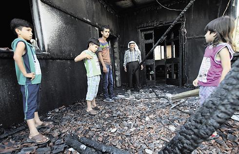 The burnt remains of the Dawabsheh family home (Photo: Shaul Golan)