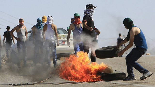 Rioting and burning tires after the funeral. (Photo: Reuters) (Photo: Reuters)