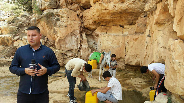 Rifat Mari said he had to walk a long way to a spring for water
