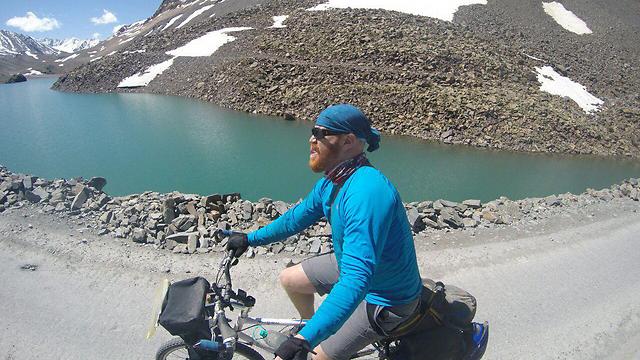 Sadan riding his bike in India