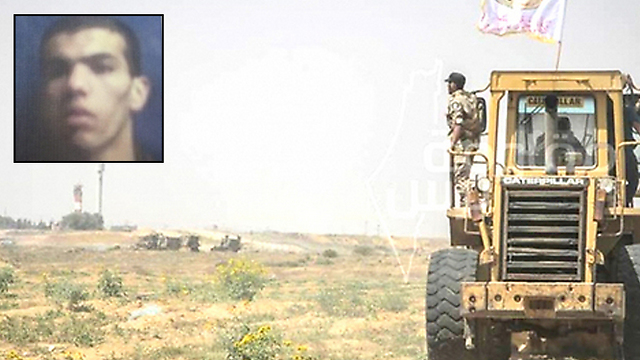 Ibrahim Shaer on the background of the road being built by Hamas on the border