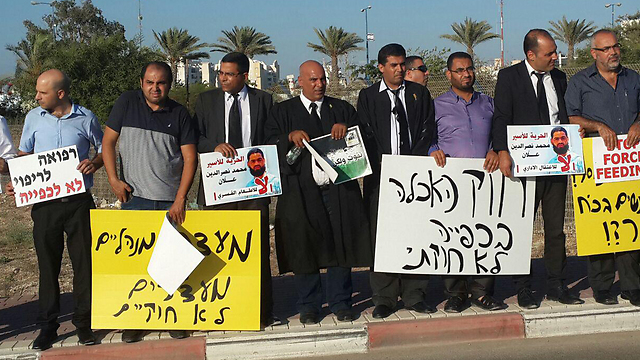 The Arab lawyers protesting outside the hospital.