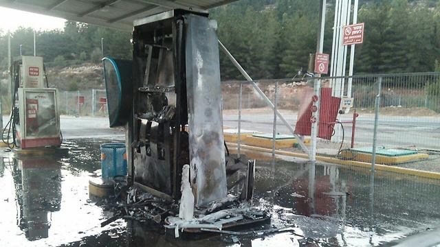 The burnt remains of the gas station (Photo: Judea and Samaria Fire Dept.)