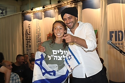 Singer Idan Raichel with Adina Karfoch (Photo: Motti Kimhi)