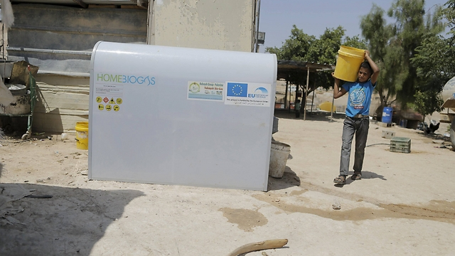 Mohammad Zayed uses a HomeBioGas digester (Photo: Ammar Awad, Reuters)