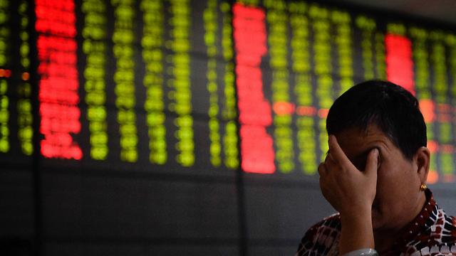 ירידות שערים בסין (צילום: MCT) (צילום: MCT)