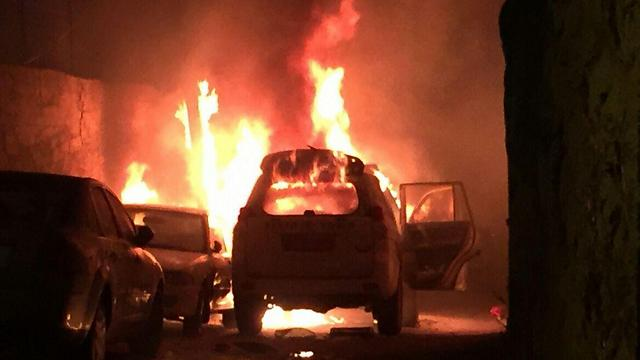 The border police vehicle after being hit by the firebomb