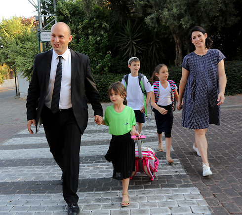 Minister Bennett, his wife and three of their children on the first day of school (Photo: Sasson Tiram)