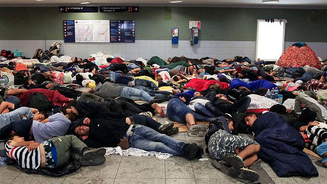 Asylum seekers sleep in Keleti Station in Budapest this week (Photo: Reuters)