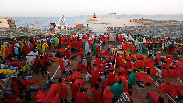 Refugees on a Norwegian ship on their way to Italy (Photo: AP)