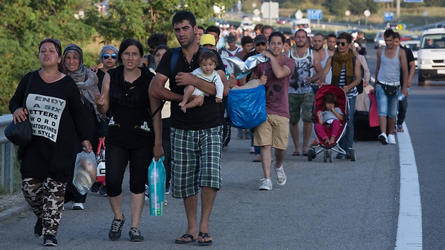 Asylum seekers march from Hungarian train station on Friday (Photo: Getty Images)