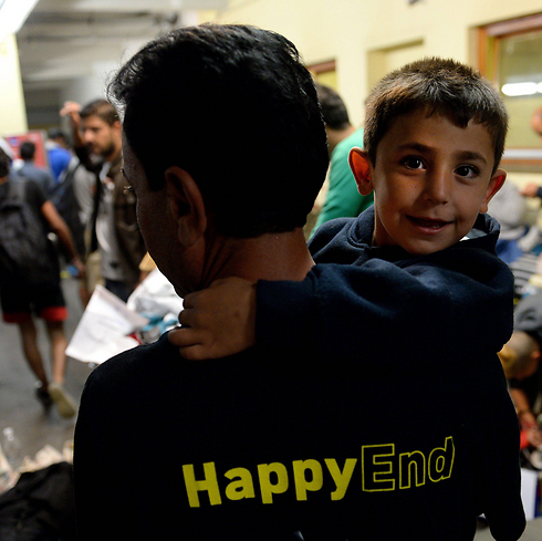 A 'happy end' for these migrants at the Vienna train station (Photo: EPA)