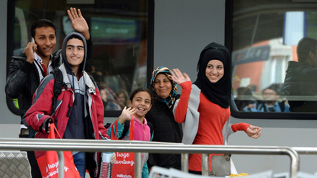Refugees in Munich, Germany. 'The refugees, who are mostly Muslims, have turned Germany into a territory in which they will set the tone and become the real rulers' (Photo: AFP)