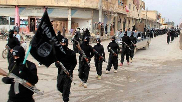 Islamic State militants in Raqqa, Syria. (Photo: AP)