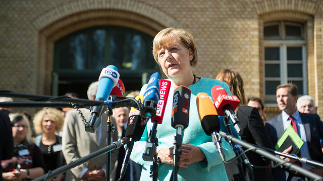 Merkel speaks to reporters (Photo: AFP)
