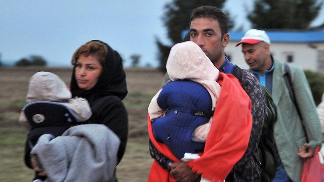 מהגרים מגיעים בימי משבר הפליטים של 2015 (צילום: AFP) (צילום: AFP)