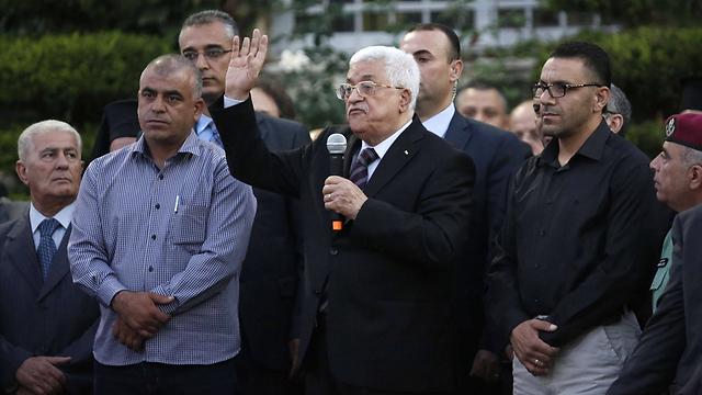 אבו מאזן. לא התייחס לפיגועים ולא גינה אותם (צילום: AFP) (צילום: AFP)
