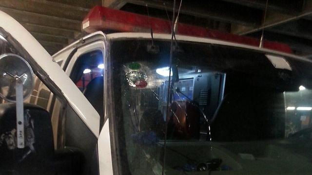 An ambulance damaged by rocks on Saturday night.
