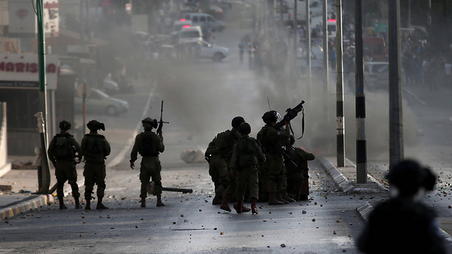 Four battalions of soldiers have been deployed to the West Bank to answer to rioters. (Photo: AFP)