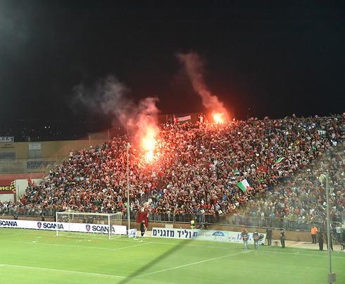 לועג למתרחש. אצטדיון דוחא (צילום: אביהו שפירא) (צילום: אביהו שפירא)