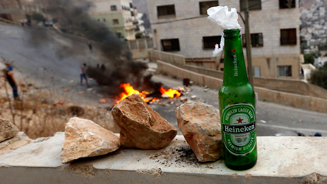 Firebombs in Nablus. (Photo: EPA)