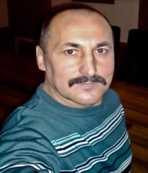 """ראש רשת המבריחים - חבר בשירות הביטחון הפדרלי הרוסי. ה""""קולונל"""" אלכסנדר אג'נקו (צילום: AP)"""