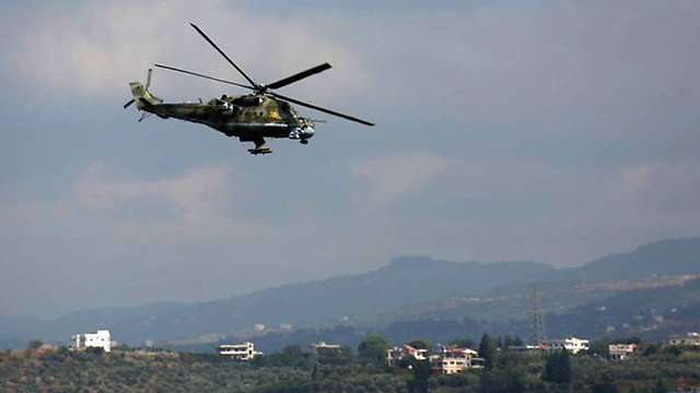 A Russian helicopter above the airport in Latakia, Syria. (Photo: MCT)