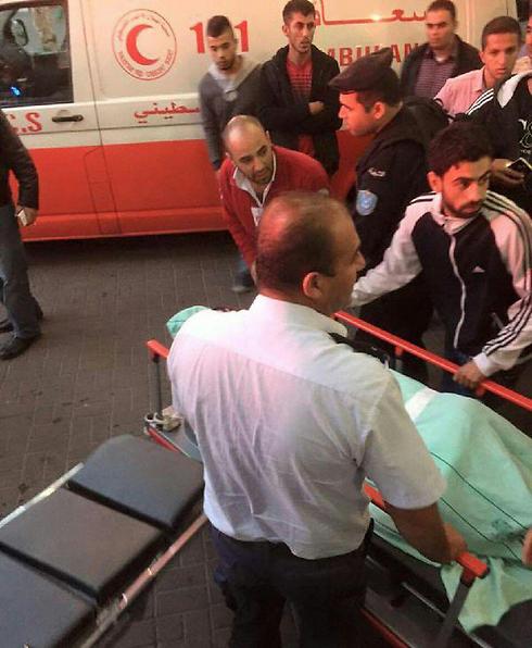 Palestinian casualty taken from the scene