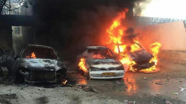 Burning cars in Shuafat