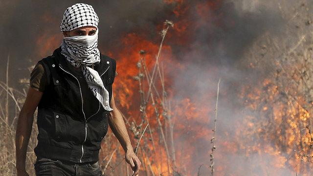 A Palestinian during Friday's riots along the Gaza border. (Photo: Reuters)