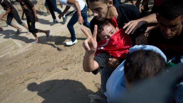 An injured Palestinian rioter (Photo: AP)