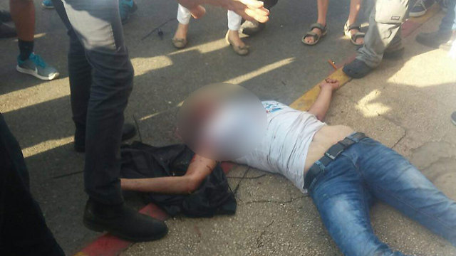 The terrorist in the first Ra'anana attack after he's been neutralized.