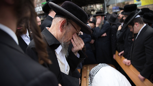 Rabbi Krishevsky's funeral. 'Going up to the Temple Mount is halachically forbidden and endangers all of us, but the attack clearly did not happen because of that' (Photo: AFP)