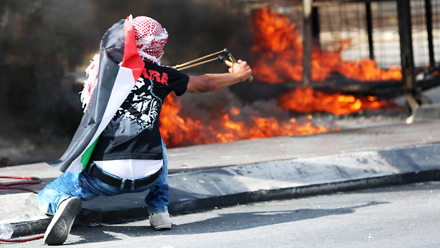 A Palestinian protester in Bethlehem (Photo: MCT)