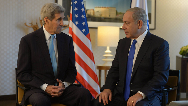 US Secretary of State John Kerry and Prime Minister Benjamin Netanyahu meeting in Berlin. (Photo: GPO)
